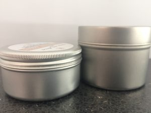 Aluminium tins containing massage bars by Cherry Essentials